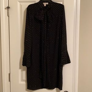 Black chiffon like dress with gold shiny dots .